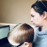 Picture of woman and child sitting at a laptop together