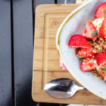 Picture of a breakfast bowl with grains, nuts and strawberries