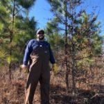 Bret Elgersma standing in an oak-pine plantation.