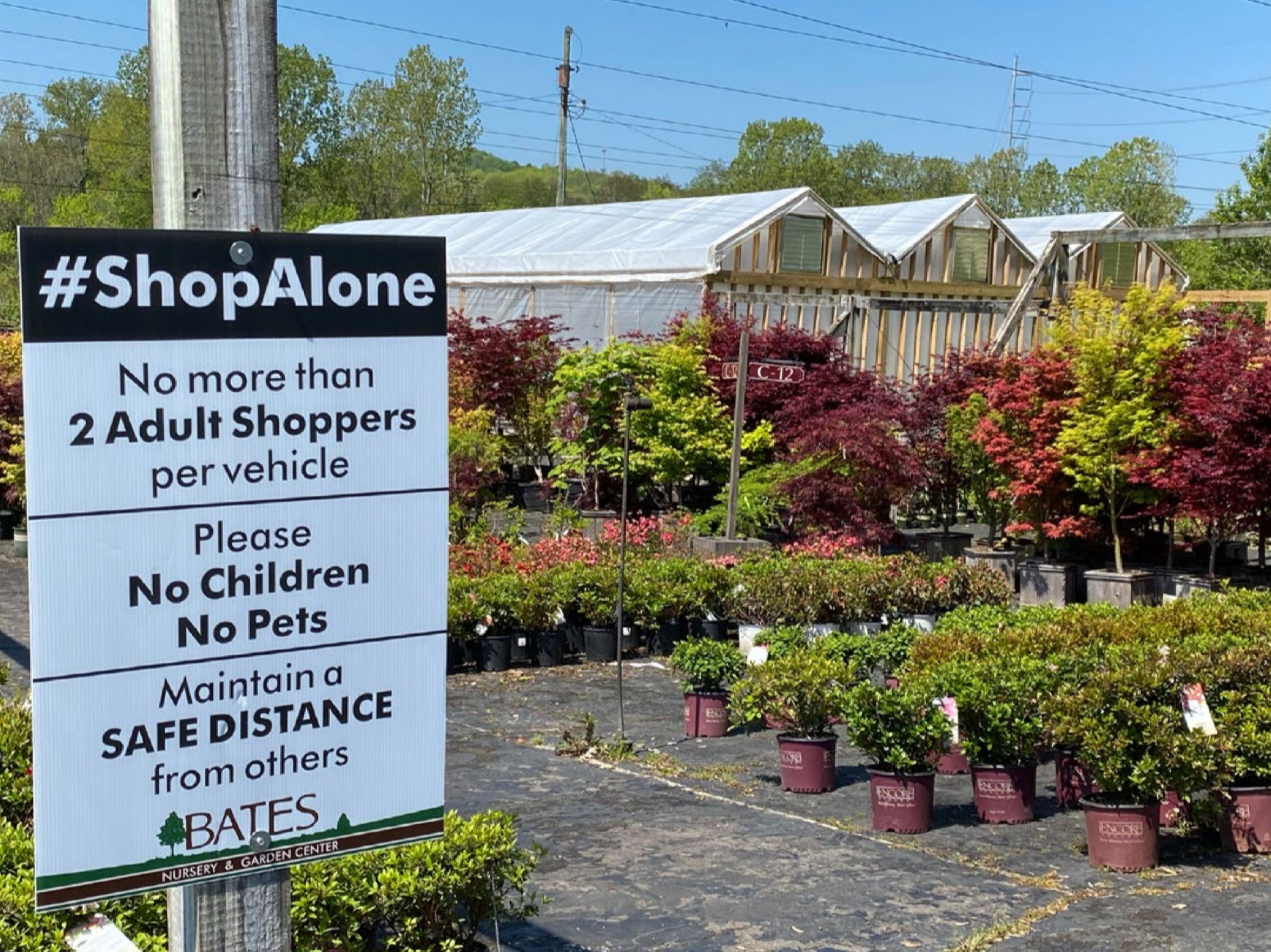 Signage in front of a garden center giving instructions on COVID-19 safety measures
