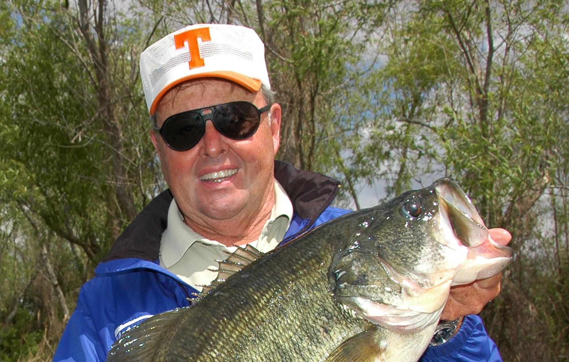Bill Dance holding Bass