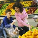 Photo of a family shopping in the produce section of a grocery store